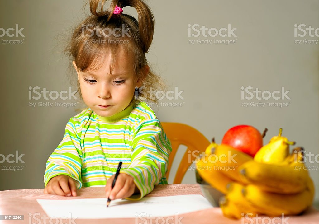 Child draws about fruit royalty-free stock photo