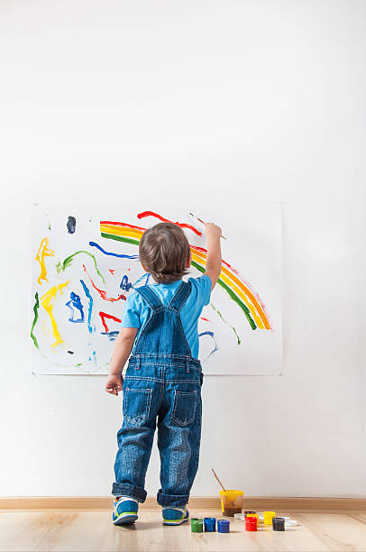 child draws ink on paper stock photo