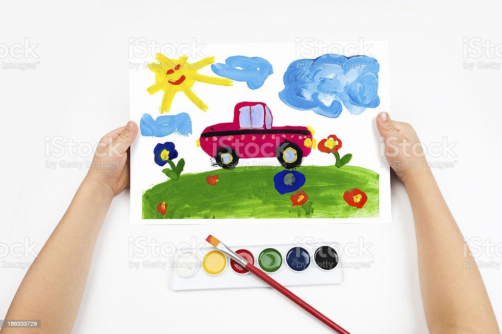 Child draws the car watercolors stock photo