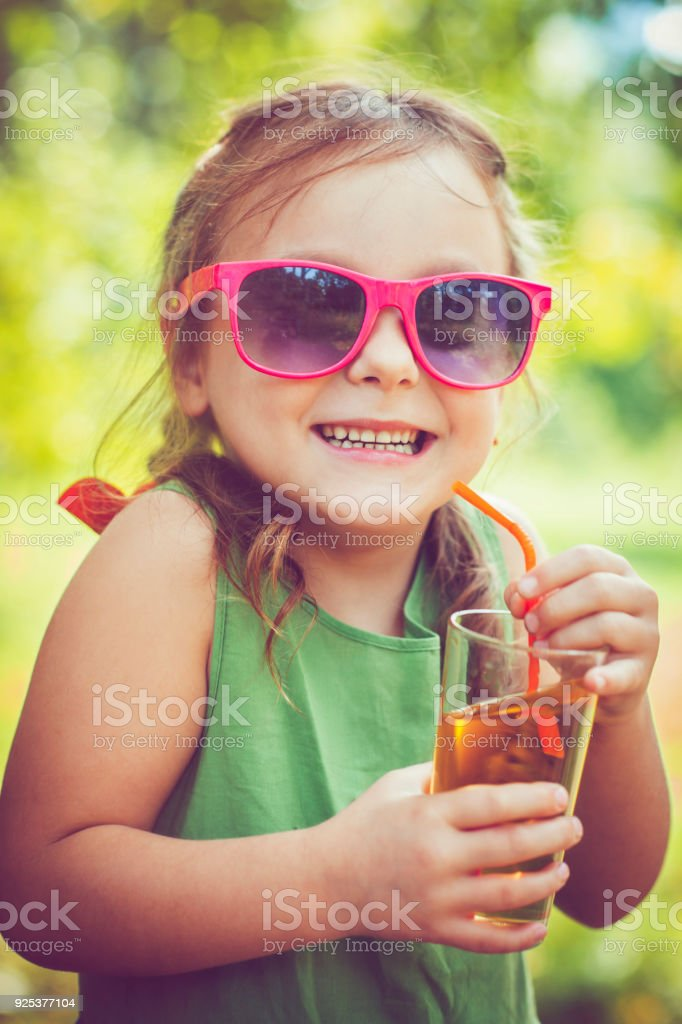 Child drinking juice stock photo