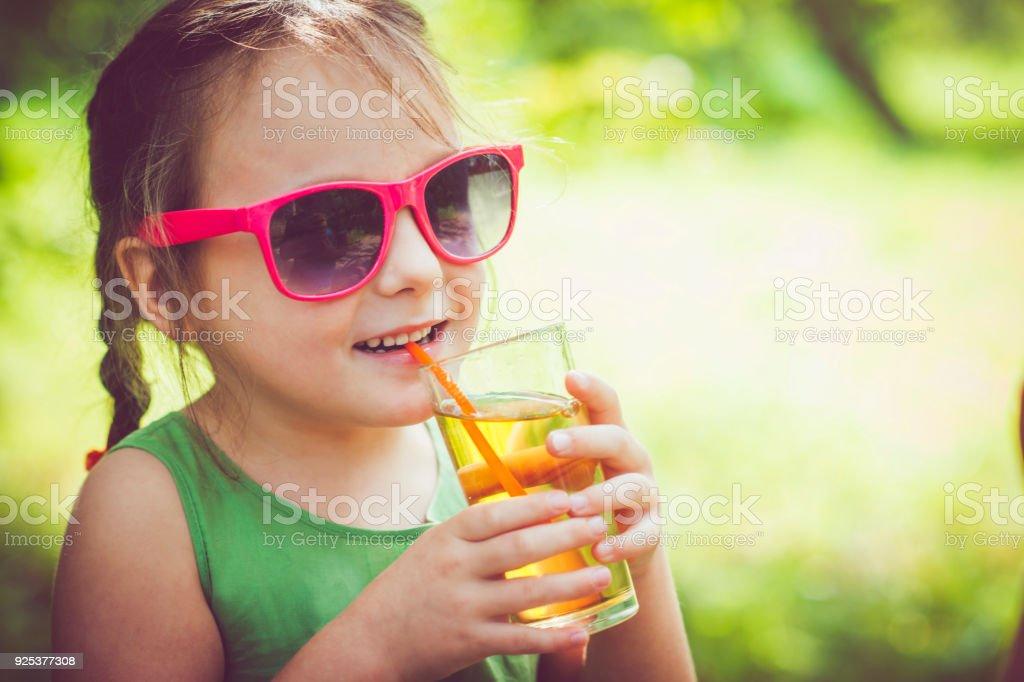 Child drinking juice stock photo