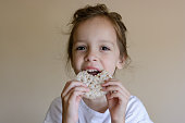 Child eating a rice cracker