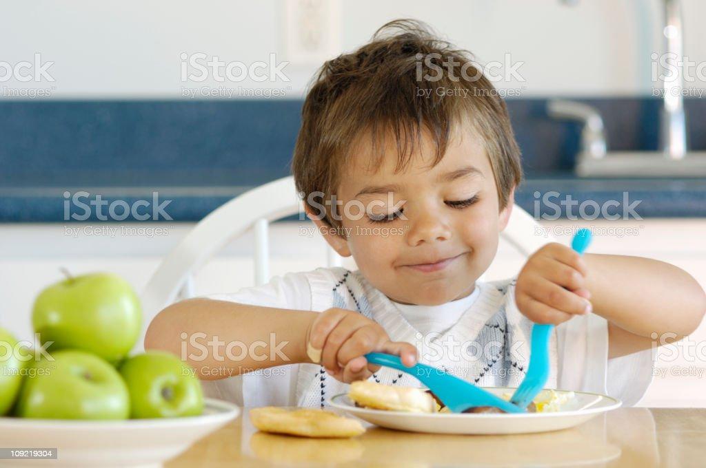 Child eating breakfast royalty-free stock photo