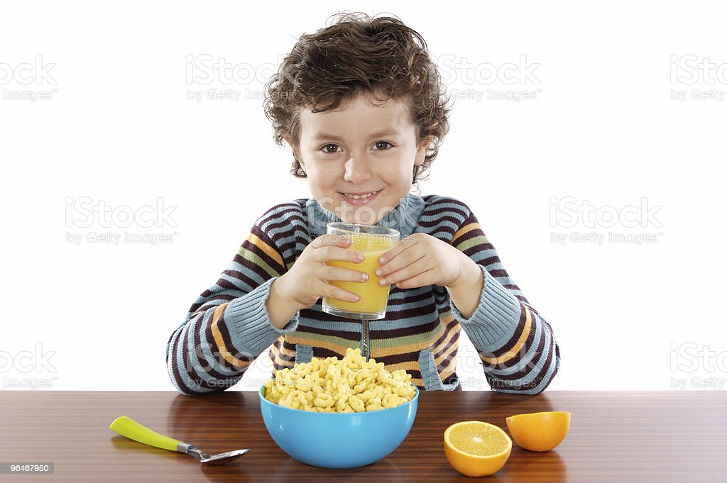 Child eating breakfast royalty-free stock photo