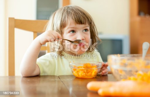 istock child eating carrot salad 180794333