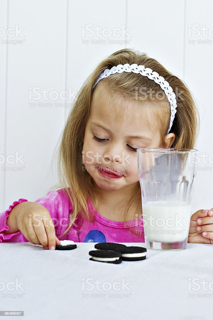 Child eating creme filled cookies royalty-free stock photo