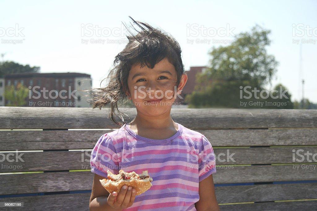 Child Eating Hamburger royalty-free stock photo