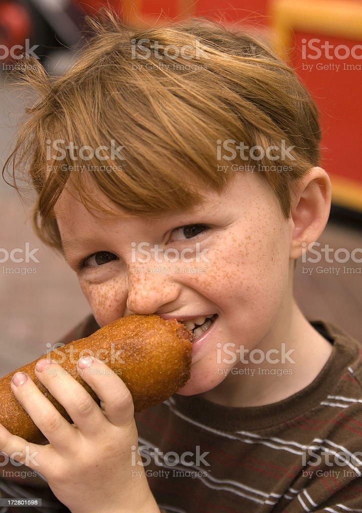 Child Eating Hot Corn Dog, Boy & School Carnival Summer Food stock photo