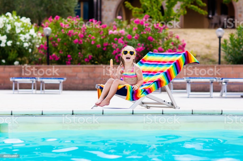 Child eating ice cream at swimming pool royalty-free stock photo