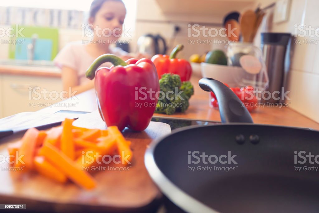 Child eating in the kitchen. stock photo