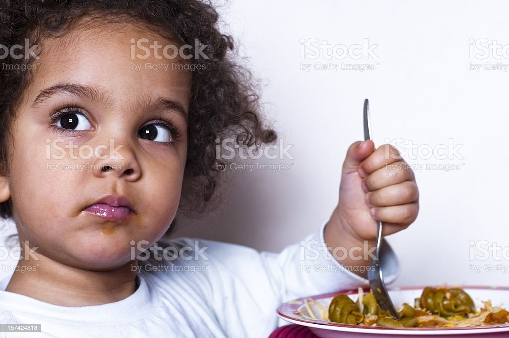 Child eating lunch stock photo