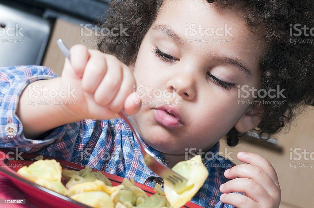 Child eating my pasta stock photo