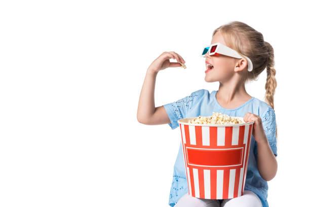 child eating popcorn isolated on white child eating popcorn isolated on white 3 d glasses stock pictures, royalty-free photos & images