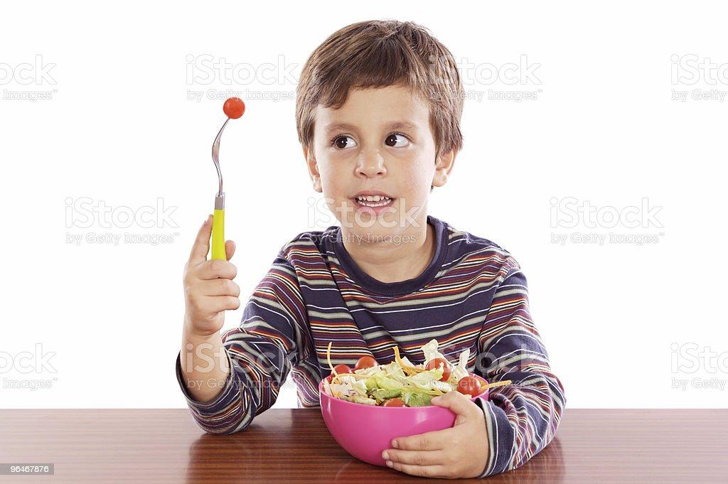 Child eating salad royalty-free stock photo