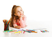 Child Education Concept, Kid Girl Drawing and Dreaming School, Lying down on White Background