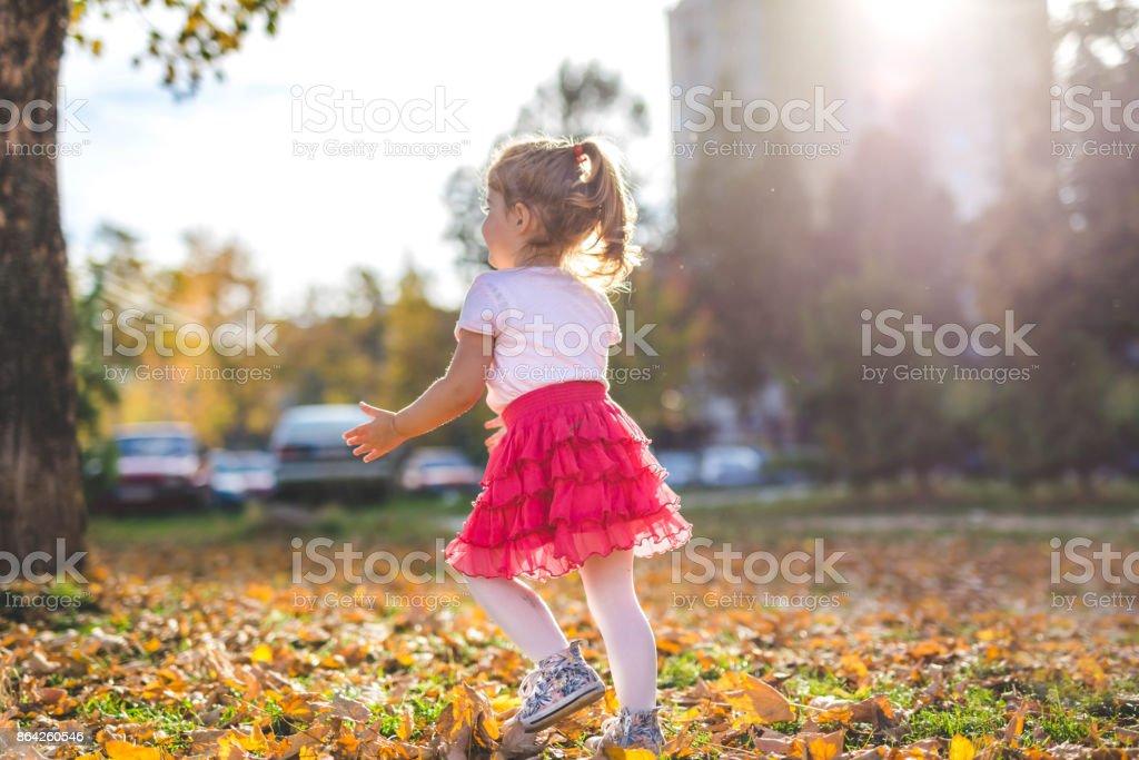 Child enjoying autumn sun royalty-free stock photo