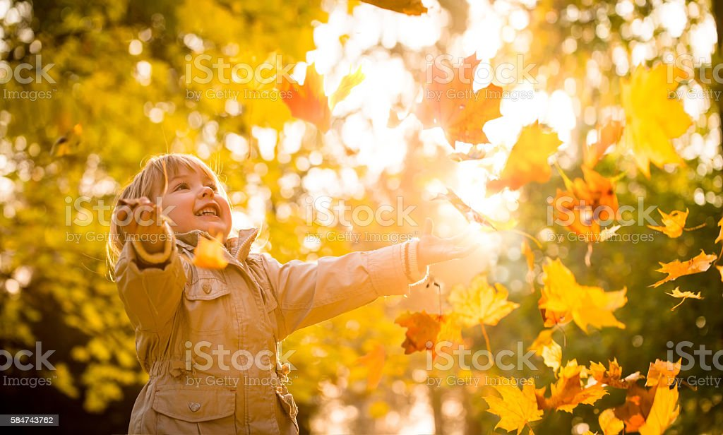 Child enjoying autumn time stock photo
