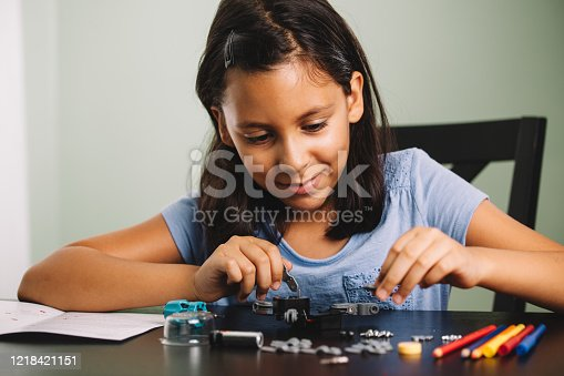 child enjoying building a robot