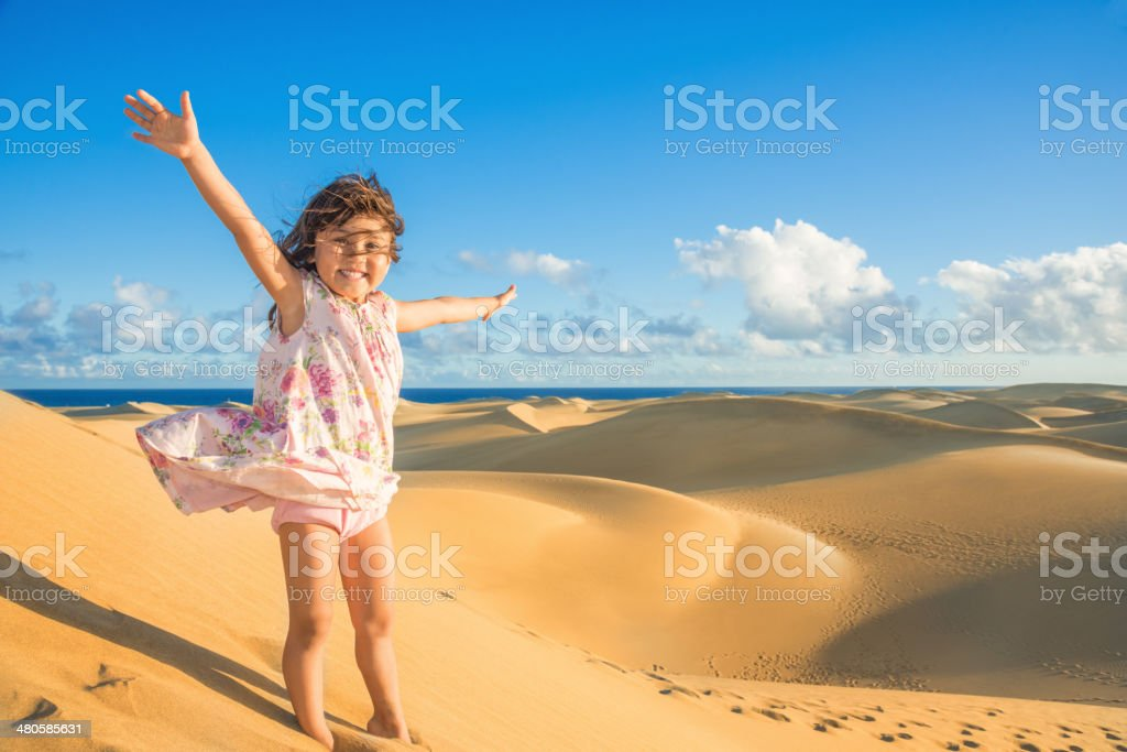 Child enjoying dunes (Maspalomas Gran Canaria) stock photo