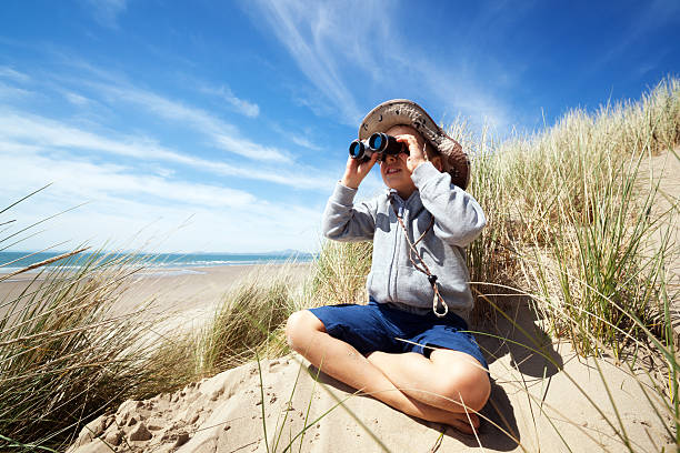 child explorer at the beach - binocular boy bildbanksfoton och bilder