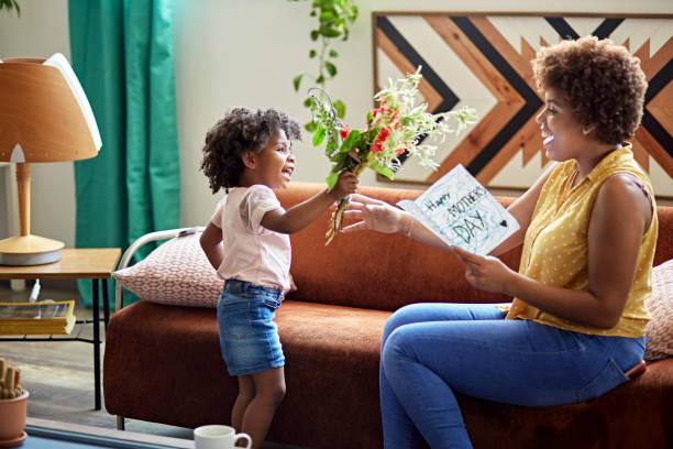 Child Expressing Gratitude and Love on Mother's Day stock photo