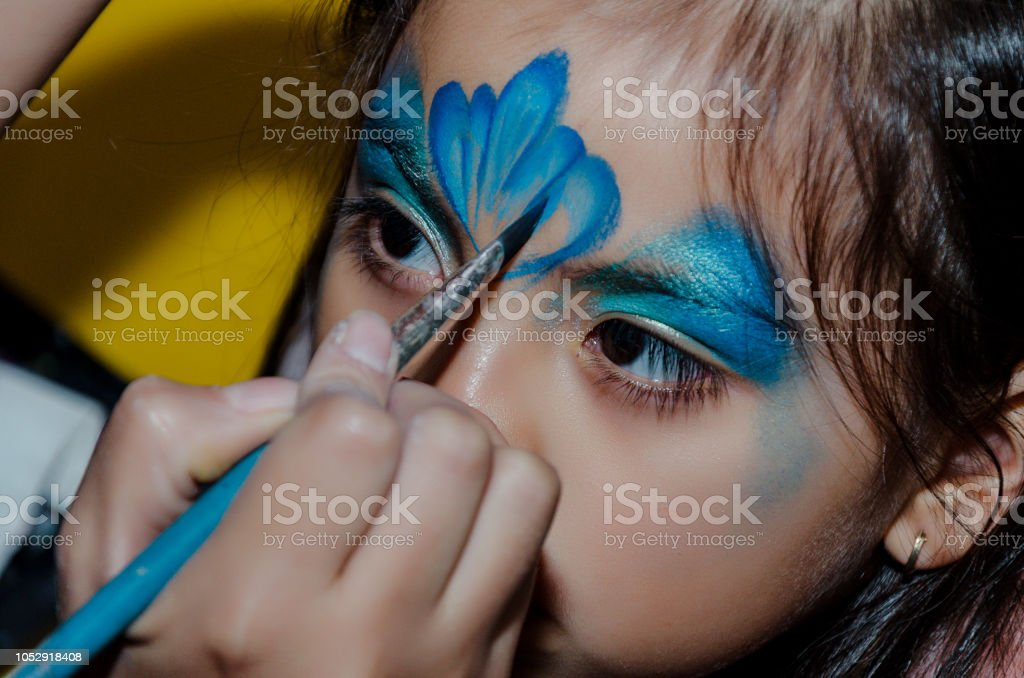 Child face art made to little girl. стоковое фото