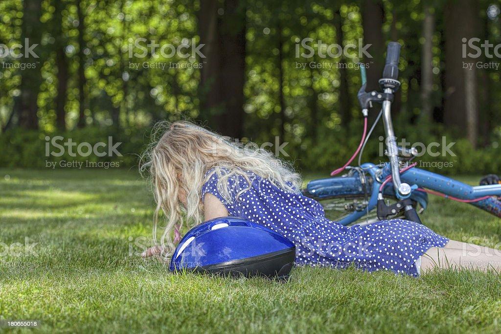 Child fallen down of bike royalty-free stock photo