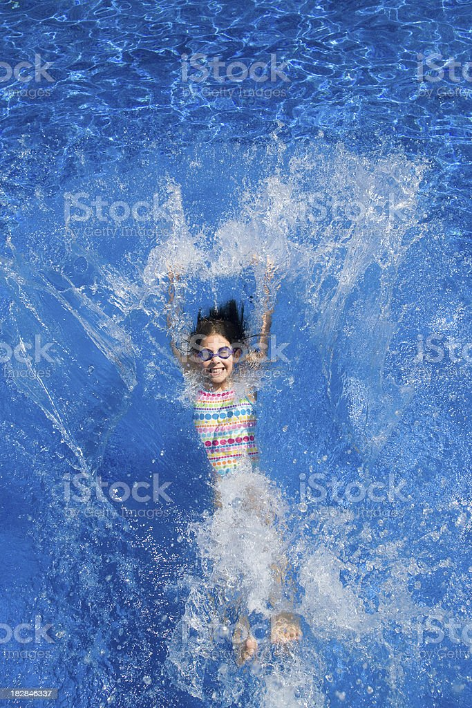 Child falling back into a swimming pool royalty-free stock photo