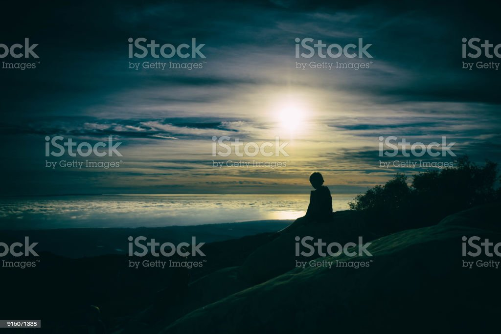 Child finds peace in the mountains stock photo