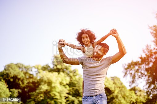 istock Child flying on father shoulders 541603564