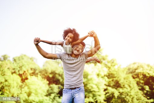 istock Child flying on father shoulders 541973454