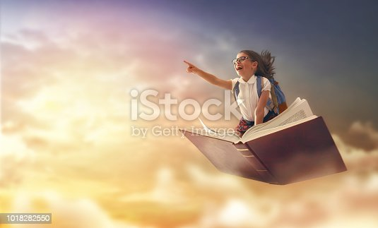 istock child flying on the book 1018282550