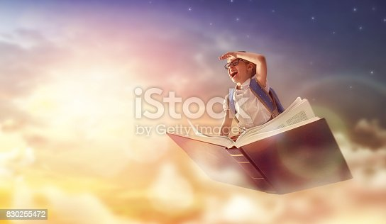 istock child flying on the book 830255472