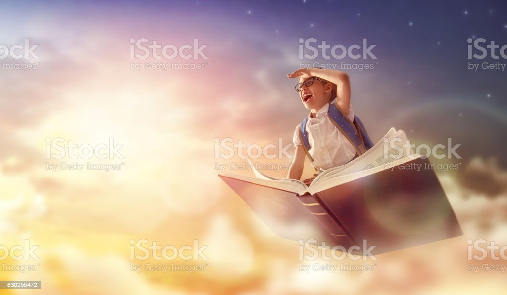 child flying on the book stock photo