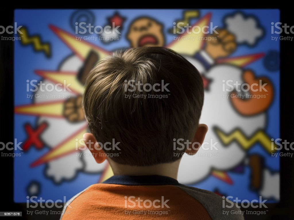 Child From Behind Watching Violent Cartoon on Television stock photo