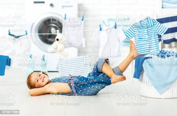 Child fun happy little girl to wash clothes in laundry room picture id670677888?b=1&k=6&m=670677888&s=612x612&h=0kmukjftn42tyunjtbfbgecmp1zepyoa298 ckrsvok=