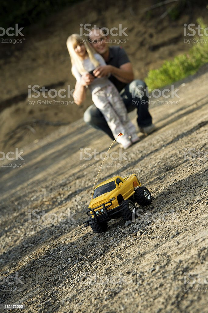 Child Girl and Father Playing with Remote Car Summer Lifestyle stock photo