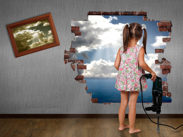 Child girl break the wall, discovery concept stock photo
