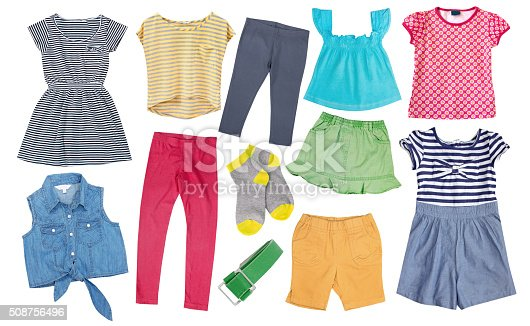 Child girl collage clothes colorful isolated on white.Kid's female apparel cotton.Set of summer bright fancy clothing.