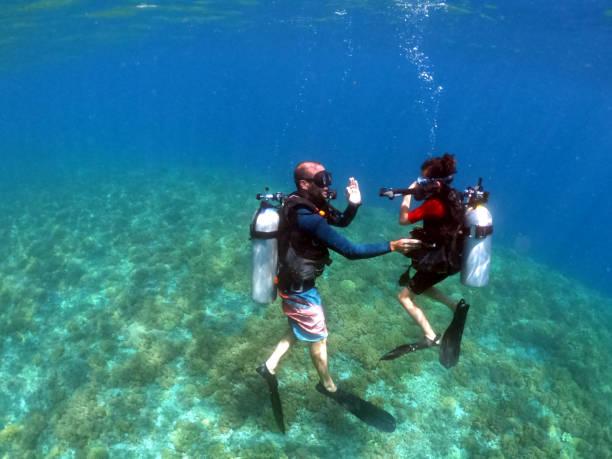 Child girl doing scuba dive course stock photo
