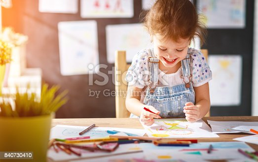 istock child  girl draws with colored pencils 840730410