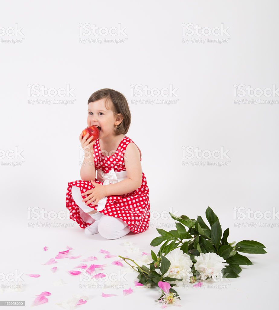 Child girl eating apple stock photo