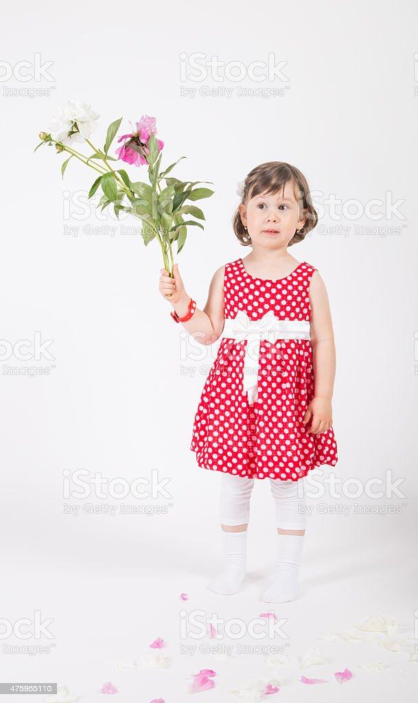 child girl holding roses stock photo