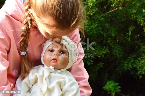 A doll with a human face. Favorite beautiful doll girls. Girl's toys. Reborn doll