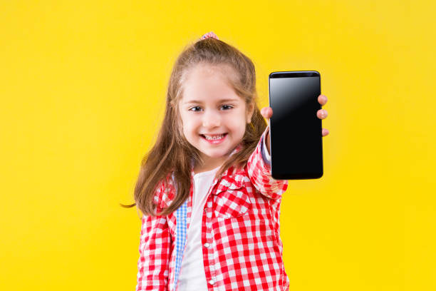 Child girl in casual cloth isolated on yellow background stock photo