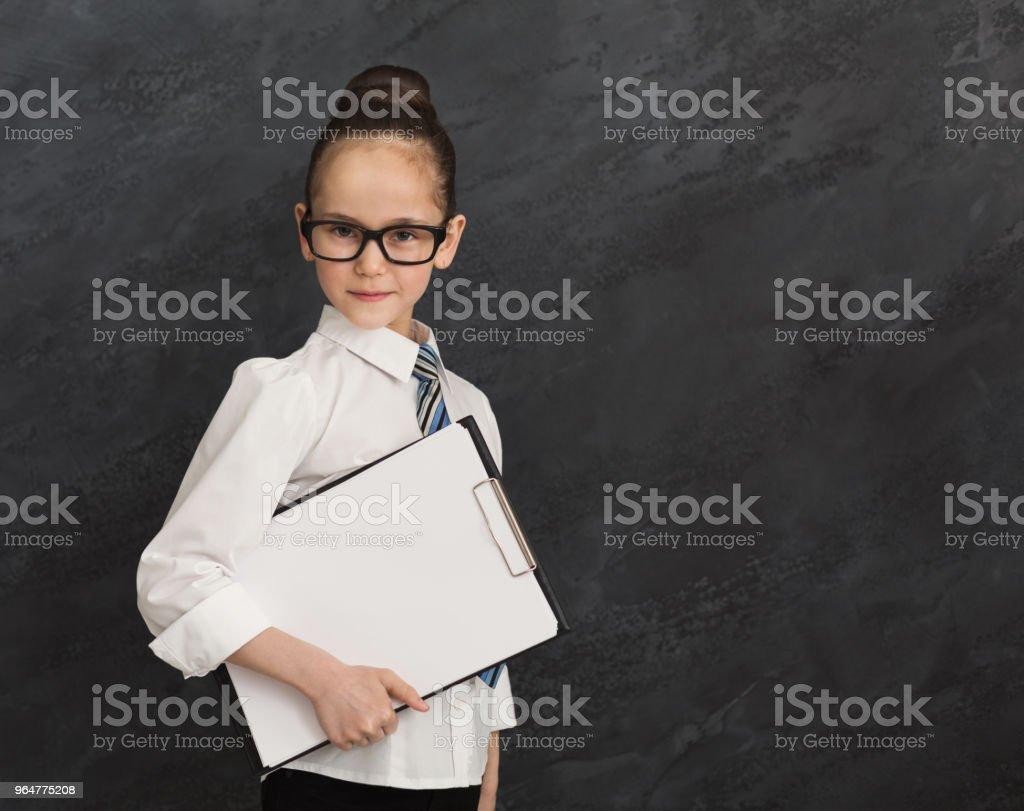 Child girl in formal wear, portrait of little businesswoman royalty-free stock photo
