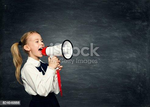 991060890 istock photo Child Girl Megaphone Announcement, School Kid Announce Scream Speaker over Blackboard 824646888
