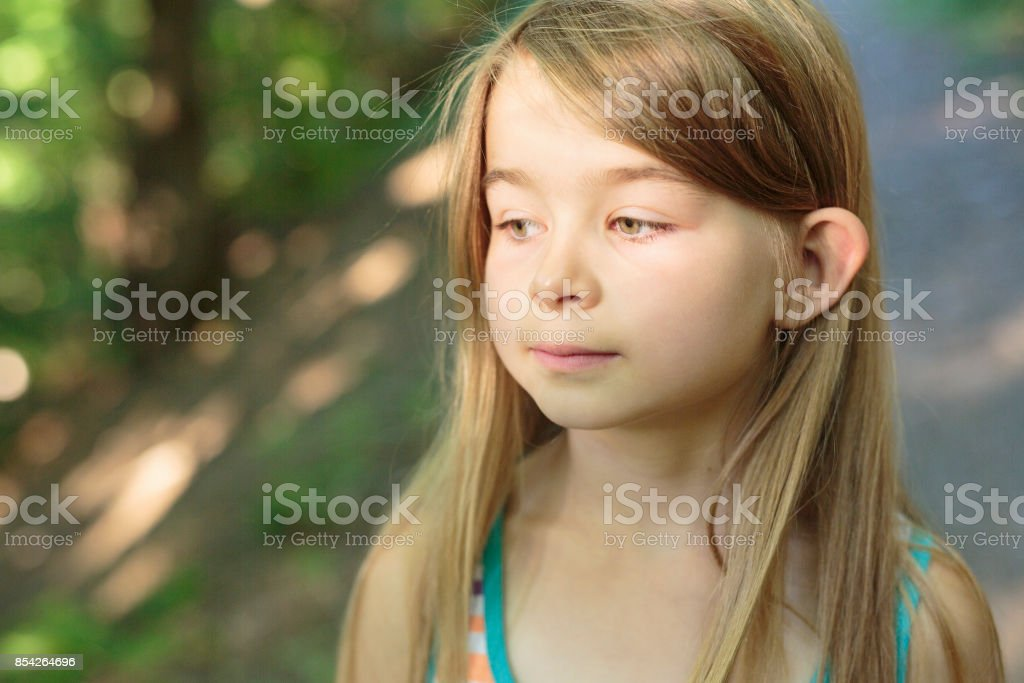 child girl on green forest stock photo