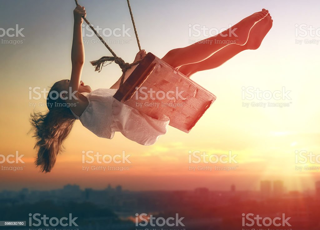 child girl on swing stock photo
