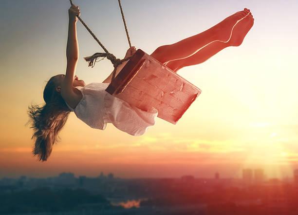 child girl on swing - altalena foto e immagini stock